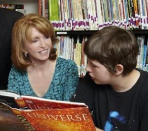 Jane with one of the children at the National Autistic Society's Sybil Elgar School